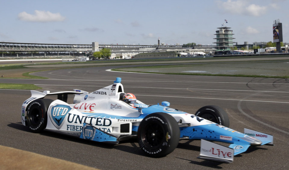 Photo - James Hinchcliffe, of Canada, drives through the first turn during practice on the first day of qualifications for Indianapolis 500 IndyCar auto race at the Indianapolis Motor Speedway in Indianapolis, Saturday, May 17, 2014. (AP Photo/AJ Mast)