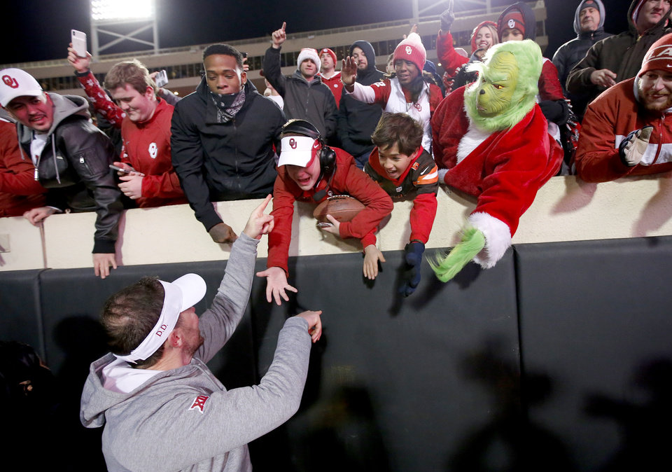 Photo - Oklahoma head coach Lincoln Riley celebrates with fans following the Bedlam college football game between the Oklahoma State Cowboys (OSU) and Oklahoma Sooners (OU) at Boone Pickens Stadium in Stillwater, Okla., Saturday, Nov. 30, 2019. OU won  34-16. [Sarah Phipps/The Oklahoman]