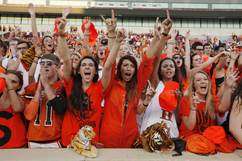 Tiger fans cheer as the Norman High School Tiger football team plays Norman North Timberwolves at Gaylord Family/Oklahoma Memorial Stadium on Thursday, Aug. 30, 2012 in Norman, Okla.  Photo by Steve Sisney, The Oklahoman