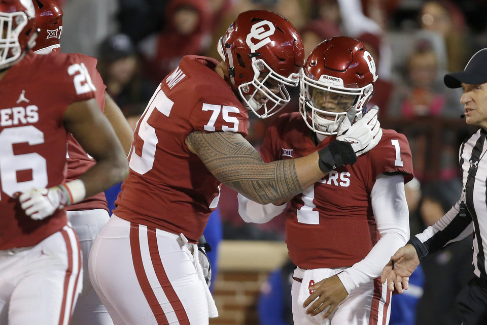 Photo - Oklahoma's Kyler Murray (1) celebrates with Dru Samia (75) after running for a touchdown during a college football game between the University of Oklahoma Sooners (OU) and the Kansas Jayhawks (KU) at Gaylord Family-Oklahoma Memorial Stadium in Norman, Okla., Saturday, Nov. 17, 2018. Photo by Bryan Terry, The Oklahoman