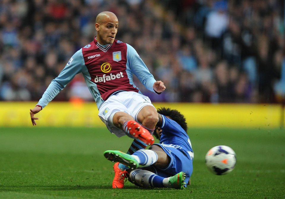 Photo - Aston Villa's Karim El Ahmadi, left, is tackled by Chelsea's Willian during the English Premier League soccer match between Aston Villa and Chelsea at Villa Park, Birmingham, England, Saturday, March 15, 2014.  (AP Photo/Rui Vieira)