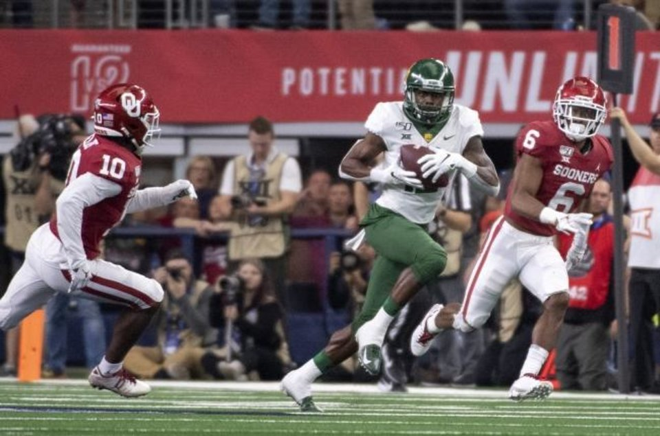 Photo -  Oklahoma's Tre Brown (6) and Pat Fields (10) chase down Baylor wide receiver Chris Platt during the second half of the Big 12 Championship Game on Dec. 7 in Arlington, Texas. [AP Photo/Jeffrey McWhorter]