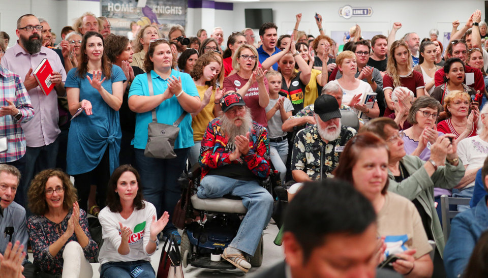 Photo -  The crowd cheers Saturday during an American Federation of Teachers rally at Northwest Classen High School in Oklahoma City. [Photo by Doug Hoke, The Oklahoman]
