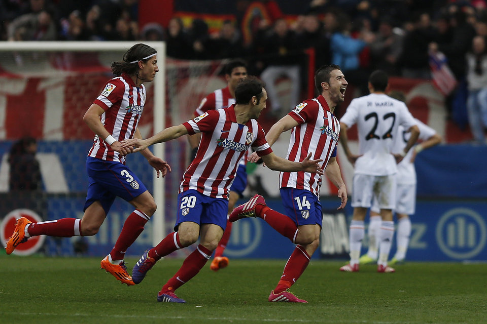 Photo - Atletico's Gabi, right, celebrates his goal during a Spanish La Liga soccer match between Atletico de Madrid and Real Madrid at the Vicente Calderon stadium in Madrid, Spain, Sunday, March 2, 2014. (AP Photo/Andres Kudacki)