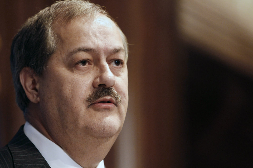 FILE -In this Thursday, July 22, 2010 file photo, Chairman and Chief Executive Officer of Massey Energy Company Don Blankenship speaks at the National Press Club in Washington. David Hughart, a former president of a Massey Energy subsidiary implicated the company\'s chief executive officer in safety violations as he pleaded guilty Thursday, Feb. 28, 2013, to charges resulting from an investigation into the 2010 explosion at a Massey mine that killed 29 men. The CEO at the time, Don Blankenship, was not mentioned by name. (AP Photo/Jacquelyn Martin, File)