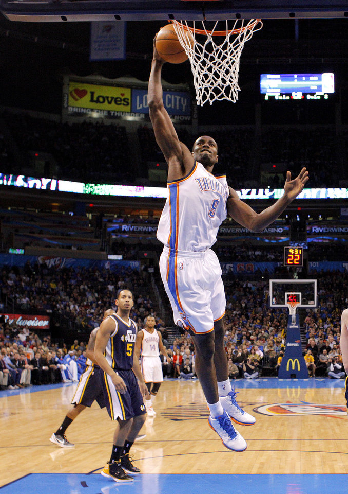 Photo - Oklahoma City's Serge Ibaka (9) dunks during an NBA game between the Oklahoma City Thunder and the Utah Jazz at Chesapeake Energy Arena in Oklahoma CIty, Tuesday, Feb. 14, 2012. Photo by Bryan Terry, The Oklahoman