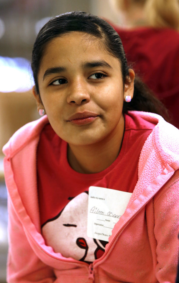 Aileen Olivares, seventh grade student at Western Heights Middle School, talks about the school's One Kid Challenge program on Saturday, Dec. 15, 2012, in Oklahoma City, Okla.  Photo by Steve Sisney, The Oklahoman