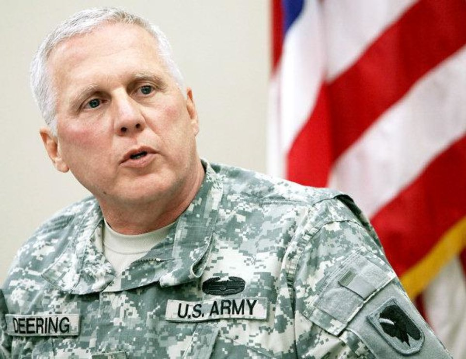 Photo - Major General Myles Deering speaks during a press conference at the Oklahoma National Guard offices in Oklahoma City on Wednesday, Dec. 30, 2009. By John Clanton, The Oklahoman ORG XMIT: KOD