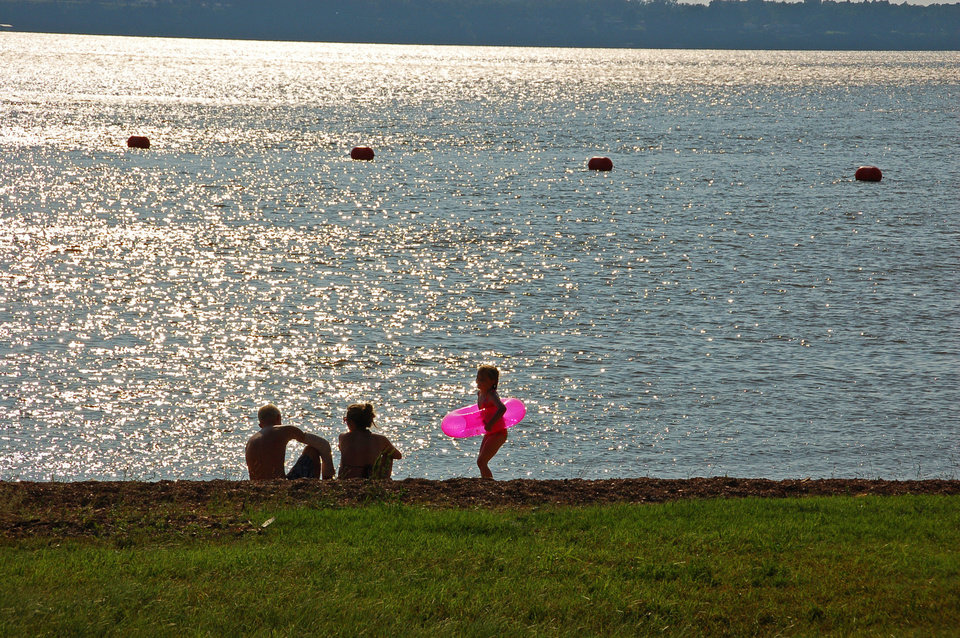 Photo - A family enjoys the cool waters of Grand Lake in northeastern Oklahoma.