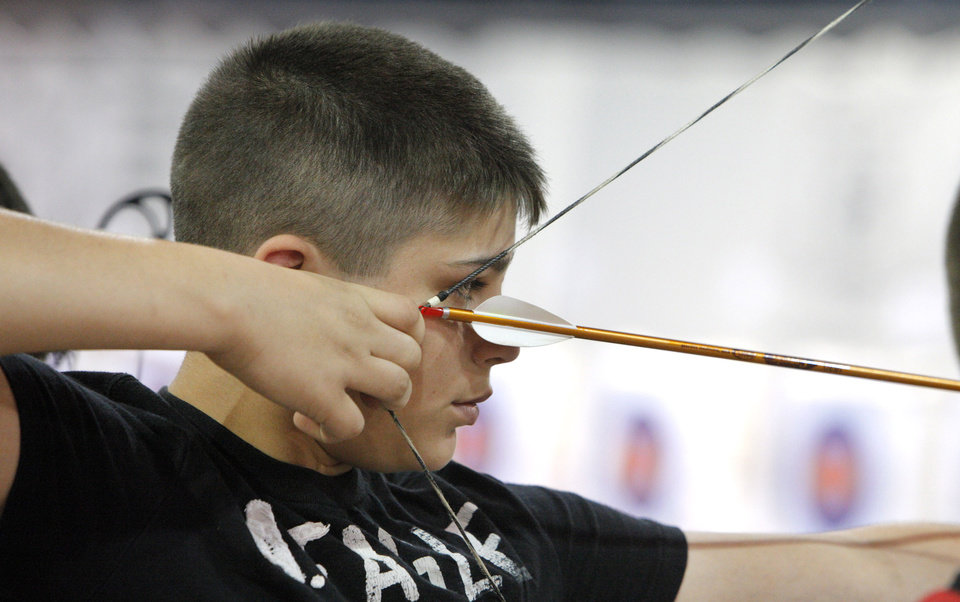 Photo - Seventh grader Matthew Jones, age 13 shooting for Moss Public Schools,  shooting in the 15 meter during the Oklahoma's National Archery in the Schools Program State Shoot at State Fair Park in Oklahoma City Wednesday, March 28, 2012. Photo by Paul B. Southerland, The Oklahoman