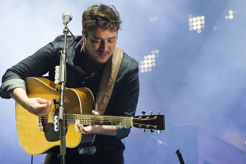 Photo - Mumford & Sons band member Marcus Mumford performs on Wednesday, Aug. 28, 2013 at the West Side Tennis Club in the Forest Hills neighborhood of the Queens borough of New York. (Photo by Charles Sykes/Invision/AP)