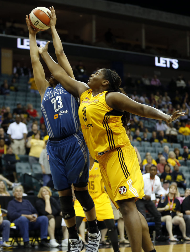 Photo - Tulsa Minnesota's Maya Moore (23) is defended by Tulsa's Courtney Paris (3), during the Shock-Lynx WNBA basketball game, at the BOK Center, on Friday, May 23, 2014. CORY YOUNG/Tulsa World
