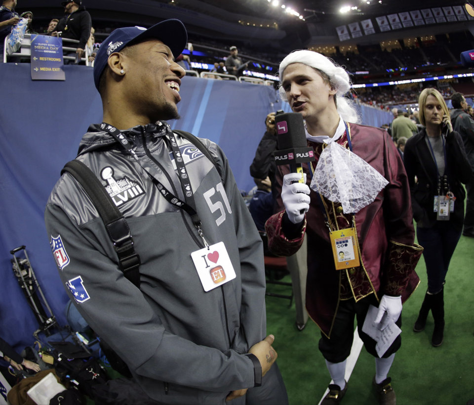 Photo - Phillip Hajszan interviews Seattle Seahawks' Bruce Irvin during media day for the NFL Super Bowl XLVIII football game Tuesday, Jan. 28, 2014, in Newark, N.J. (AP Photo/Charlie Riedel)