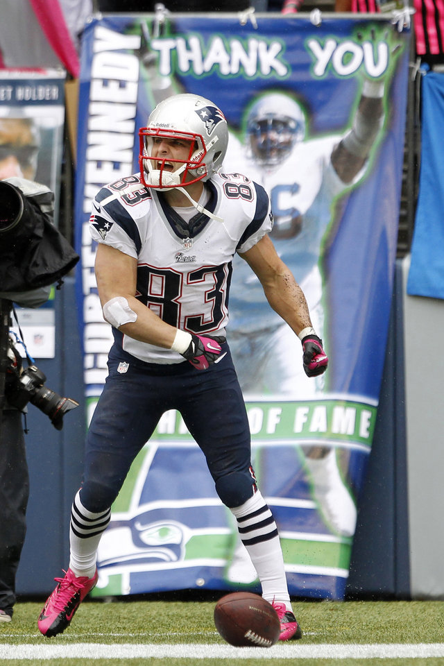 New England Patriots\' Wes Welker celebrates his touchdown against the Seattle Seahawks in the first half of an NFL football game, Sunday, Oct. 14, 2012, in Seattle. (AP Photo/Elaine Thompson) ORG XMIT: SEA110