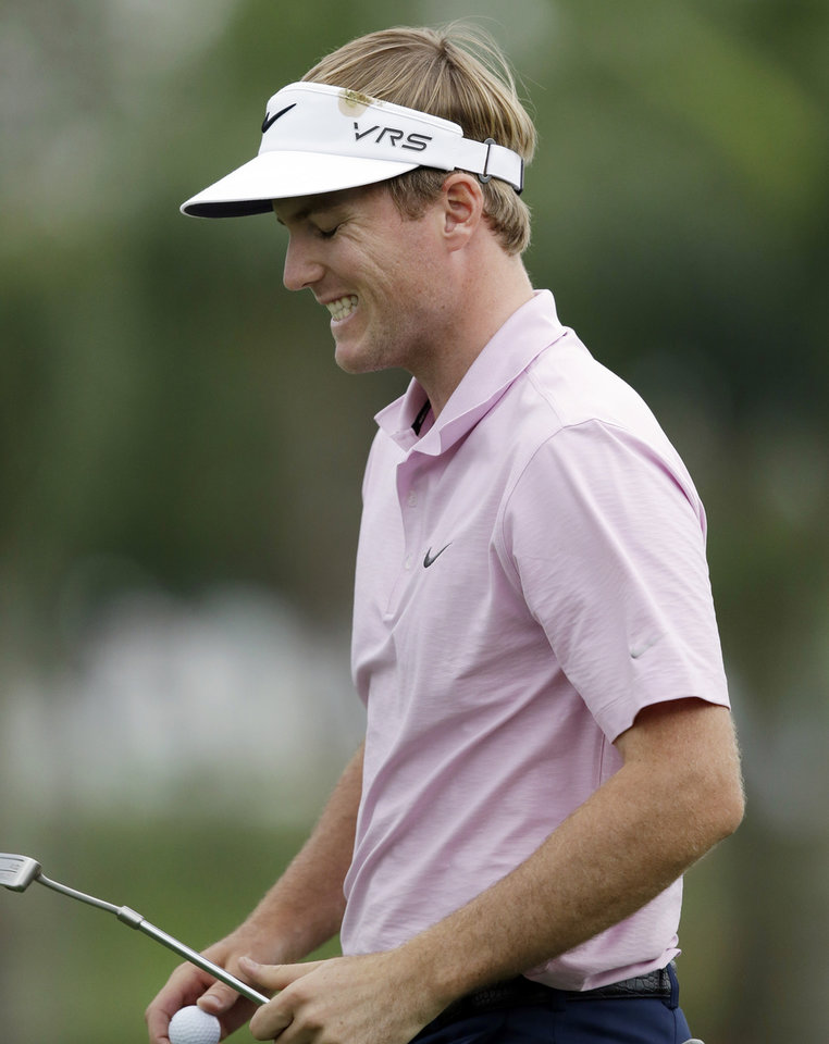 Photo - Russell Henley reacts after missing a putt on the ninth hole during the first round of the Honda Classic golf tournament on Thursday, Feb. 27, 2014, in Palm Beach Gardens, Fla. (AP Photo/Wilfredo Lee)