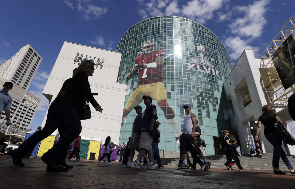 Photo - A large image of San Francisco 49ers quarterback Colin quarterback Colin Kaepernick decorates a building in New Orleans, Saturday, Feb. 2, 2013. The city hosts NFL football's Super Bowl XLVII between the San Francisco 49ers and Baltimore Ravens on Sunday. (AP Photo/Marcio Jose Sanchez)