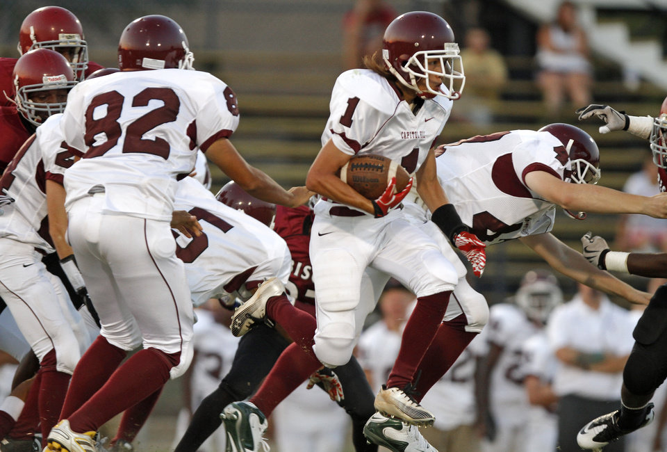 Photo - Capitol Hill's Denny Do runs the ball against Oklahoma Centennial during a high school football game at Star Spencer in Oklahoma City, Thursday, September 1, 2011. Photo by Bryan Terry, The Oklahoman ORG XMIT: KOD