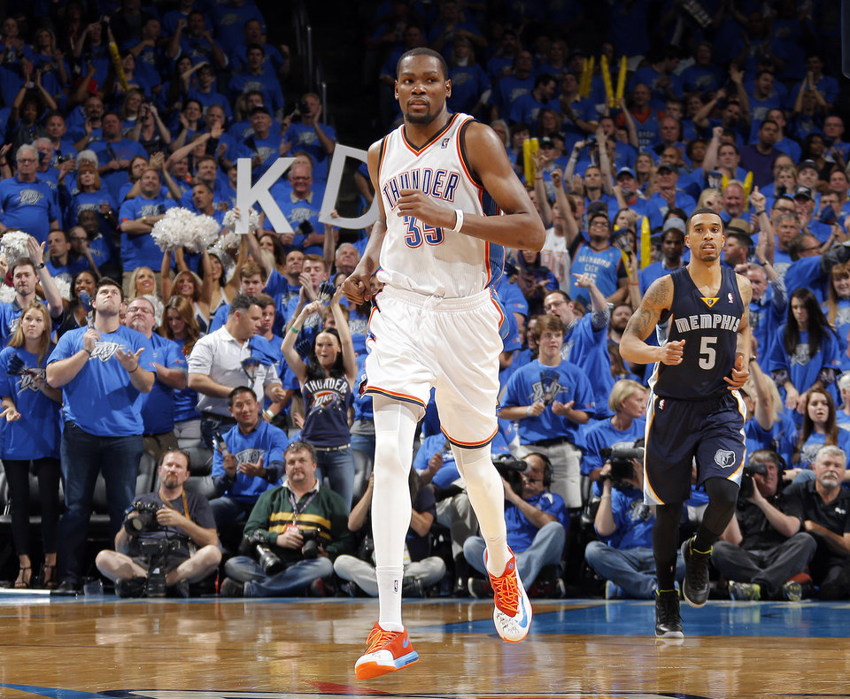 Photo - Oklahoma City's Kevin Durant (35) runs up court after a basket during Game 1 in the first round of the NBA playoffs between the Oklahoma City Thunder and the Memphis Grizzlies at Chesapeake Energy Arena in Oklahoma City, Saturday, April 19, 2014. Photo by Sarah Phipps, The Oklahoman