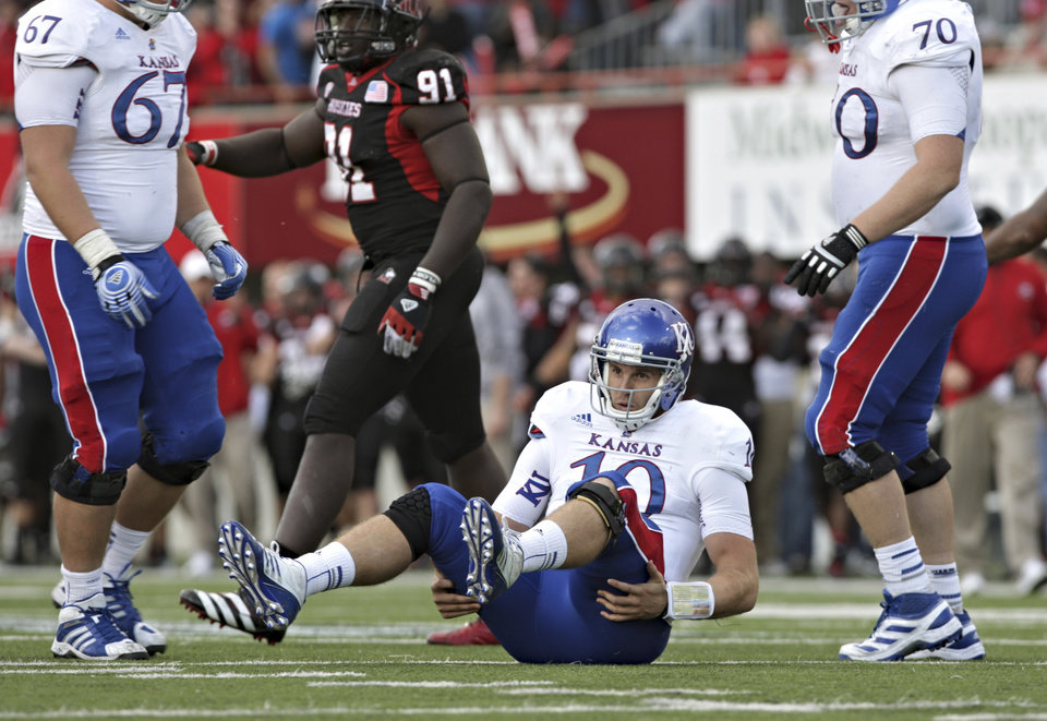 Photo -   Kansas quarterback Dayne Crist gets up off the turf after being hit on a pass attempt late during the fourth quarter against Northern Illinois during an NCAA college football game in DeKalb, Ill., on Saturday, Sept. 22, 2012. Northern Illinois defeated Kansas 30-23. (AP Photo/Daily Chronicle, Rob Winner) CHICAGO LOCALS OUT ROCKFORD OUT