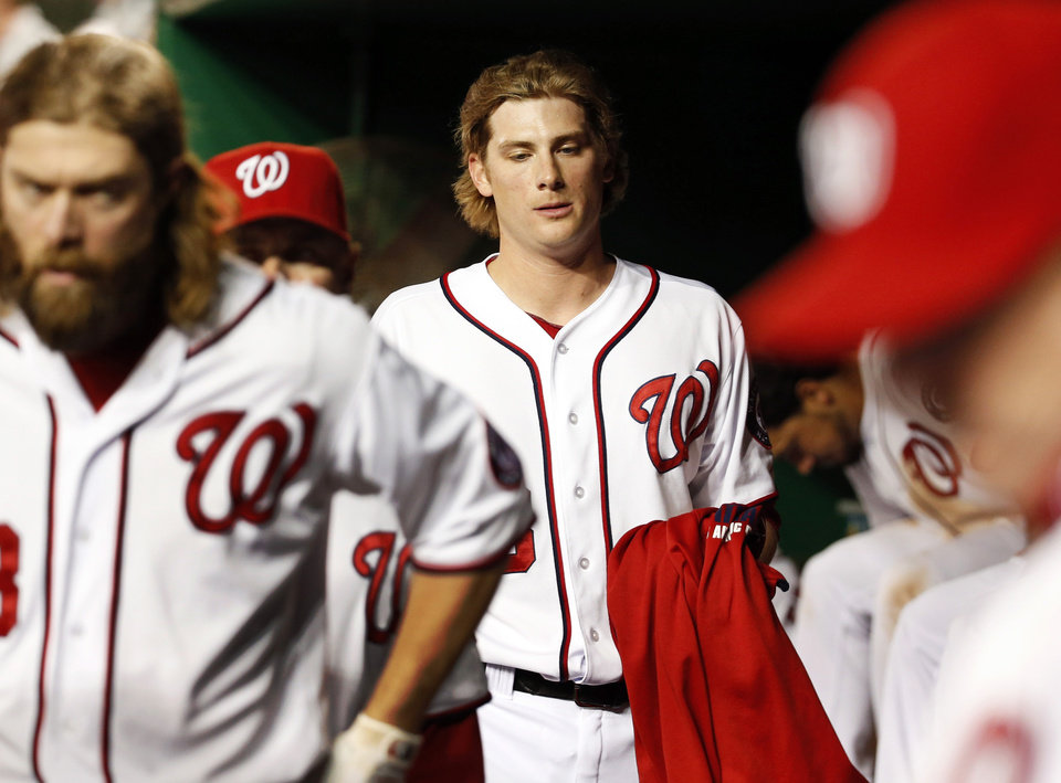 Photo - Washington Nationals relief pitcher Ross Detwiler, center, walks in the dugout after giving up a two-run homer during the 15th inning of a baseball game against the Cincinnati Reds at Nationals Park, Monday, May 19, 2014, in Washington. The Reds won 4-3 in 15 innings. (AP Photo/Alex Brandon)