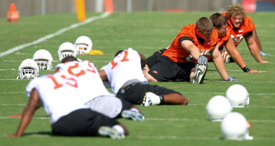 Players stretch during the first Oklahoma State University fall football practice, in Stillwater, Okla., Thursday, July 31, 2008. BY MATT STRASEN, THE OKLAHOMAN