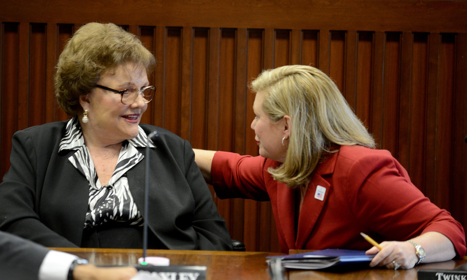 Photo -   Public Service Commission president Lucy Baxley, left, talks with opposing PSC presidential candidate Twinkle Cavanaugh, Tuesday, Nov. 6, 2012, after the PSC meeting in Montgomery, Ala. (AP Photo/Montgomery Advertiser, Julie Bennett)
