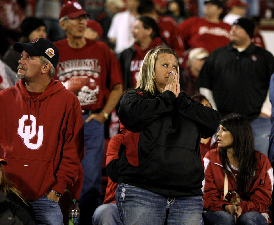 Photo - Oklahoma fans react during the college football game between the University of Oklahoma Sooners (OU) and the Texas Tech University Red Raiders (TTU) at Gaylord Family-Oklahoma Memorial Stadium in Norman, Okla., Sunday, Oct. 23, 2011. Oklahoma lost 41-38. Photo by Bryan Terry, The Oklahoman