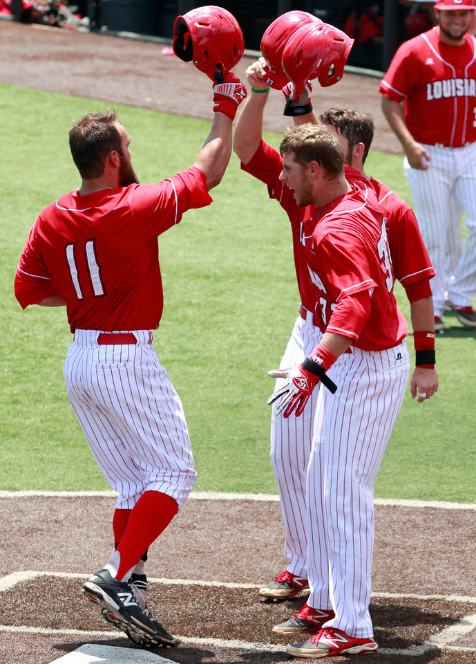 Photo - Louisiana-Lafayette catcher Michael Strentz (11) celebrates after hitting a three-run home run in the second inning during an NCAA college baseball tournament regional game against San Diego State in Lafayette, La., Saturday, May 31, 2014. Louisiana-Lafayette won 9-2. (AP Photo/Jonathan Bachman)