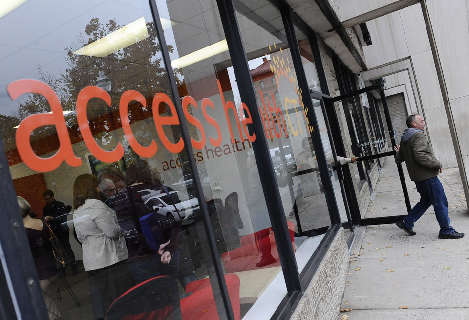Photo - A man leaves Access Health CT, Connecticut's health insurance exchange's first insurance store, Thursday, Nov. 7, 2013, in New Britain, Conn.  The site, where people can visit to sign up for coverage, is the first in the nation. (AP Photo/Jessica Hill)