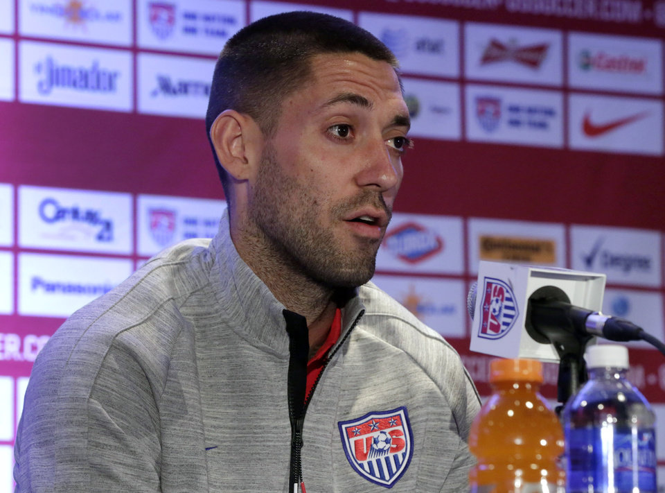 Photo - U.S. World Cup soccer team captain Clint Dempsey answers questions during a news conference in New York, Friday, May 30, 2014. The team is holding a pep rally in Times Square leading to Sunday's exhibition against Turkey, the second of three warmup matches for the Americans before next month's tournament in Brazil. (AP Photo/Richard Drew)
