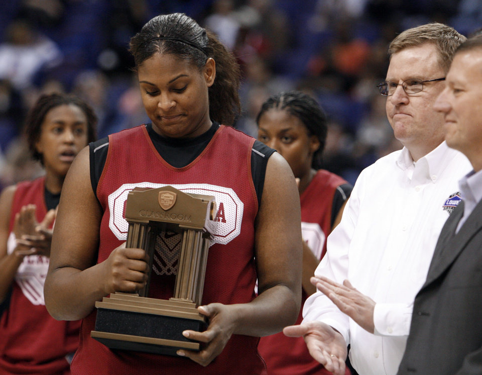 Photo - University of Oklahoma Sooner Courtney Paris accepts the outstanding senior award after practice at the 2009 NCAA women's basketball tournament Final Four in the Scottrade Center in Saint Louis, Missouri on Saturday, April 4, 2009.  Photo by Steve Sisney, The Oklahoman