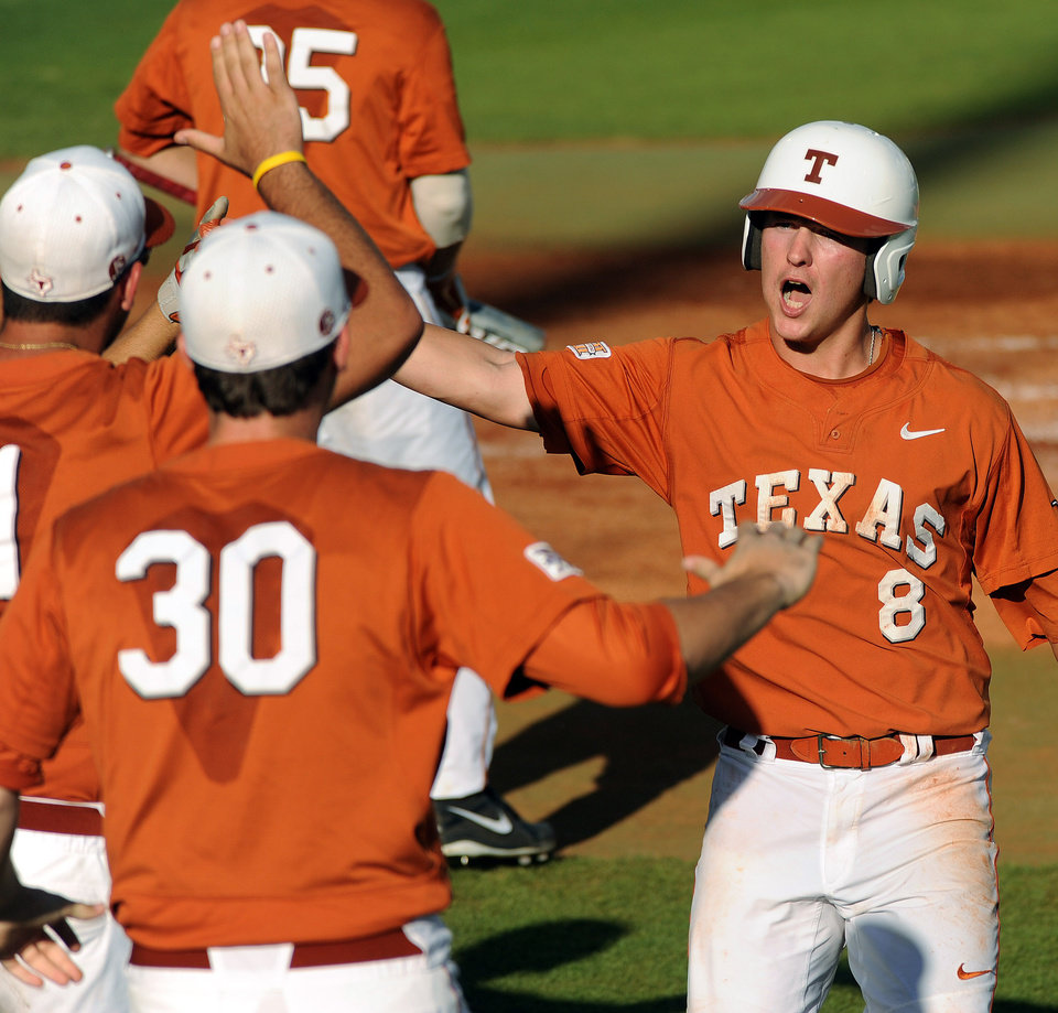 Photo - Texas' Brooks Marlow (8) celebrates scoring the Longhorns' first run of the game during the first inning of an NCAA baseball regional game against Texas A&M, Monday, June 2, 2014, at Reckling Park in Houston.  (Photo: Eric Christian Smith/For the Chronicle)