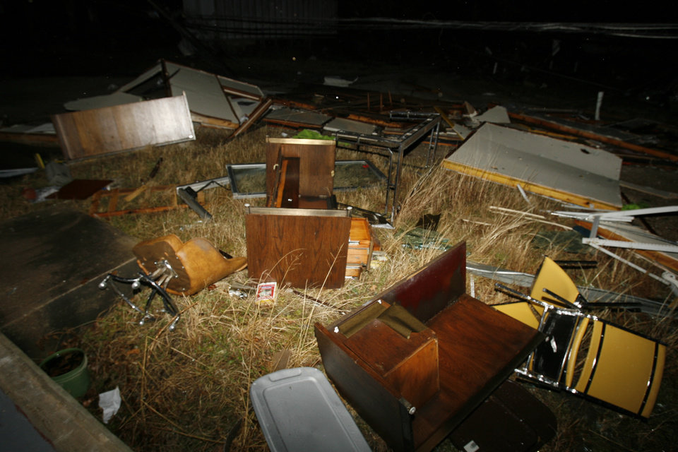 Photo - The Chamber of Commerce office furniture and walls are strewn across grass after a tornado killed at least 8 people and destroyed much of the city of Lone Grove in southern, Okla. on Tuesday, Feb. 10, 2009.   Photo by Steve Sisney, The Oklahoman