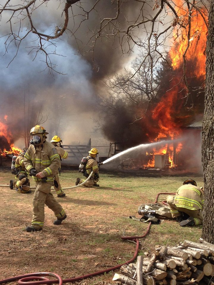 Photo -  Fire crews work to put out a fire after a barn exploded. Edmond Fire Chief Doug Hall said the department received a call that a barn had exploded at 3436 E. Waterloo. [Photo provided]