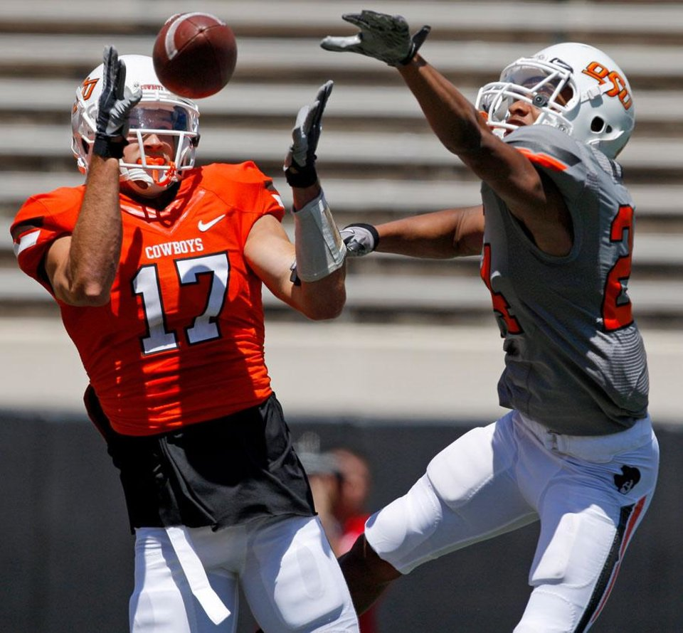 Photo -  OSU's Charlie Moore catches a touchdown pass in front of OSU's Miketavius Jones during Oklahoma State's spring football game at Boone Pickens Stadium in Stillwater, Okla., Saturday, April 21, 2012. Photo by Bryan Terry, The Oklahoman