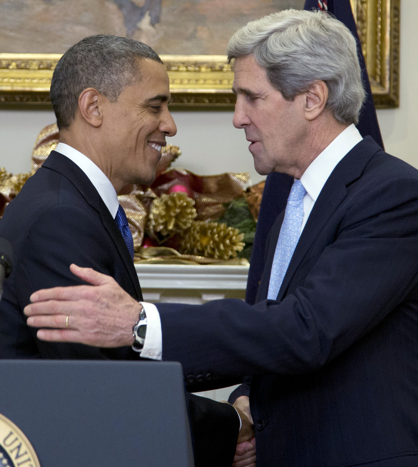 President Barack Obama, left, shakes hands with  Sen. John Kerry, D-Mass., as he announces his nomination of Kerry as next secretary of state in the Roosevelt Room of the White House, Friday, Dec. 21, 2012, in Washington. (AP Photo/Carolyn Kaster)