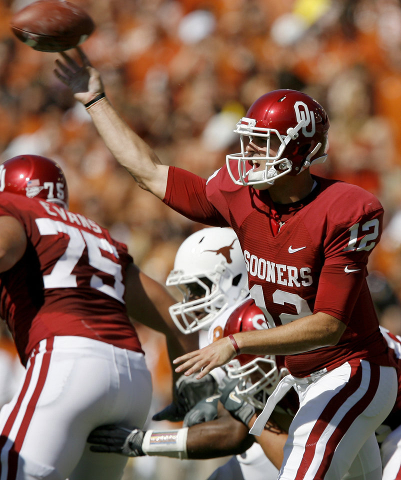 Photo - OU's Landry Jones throws a pass during the first half of the Red River Rivalry college football game between the University of Oklahoma Sooners (OU) and the University of Texas Longhorns (UT) at the Cotton Bowl on Saturday, Oct. 2, 2010, in Dallas, Texas.   Photo by Bryan Terry, The Oklahoman