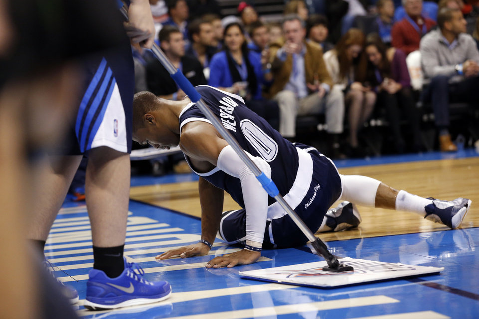 Oklahoma City Thunder\'s Russell Westbrook (0) sits at on the sidelines after an injury as the Oklahoma City Thunder play the Phoenix Suns in NBA basketball at the Chesapeake Energy Arena in Oklahoma City, on Monday, Dec. 31, 2012. Photo by Steve Sisney, The Oklahoman