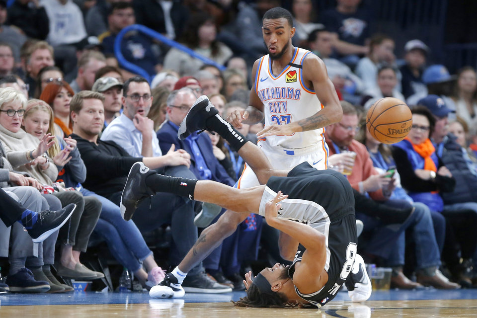 Photo - San Antonio's Patty Mills (8) passes the ball as he rolls over in front of Oklahoma City's Terrance Ferguson (23) during an NBA basketball game between the Oklahoma City Thunder and the San Antonio Spurs at Chesapeake Energy Arena in Oklahoma City, Tuesday, Feb. 11, 2020. [Bryan Terry/The Oklahoman]