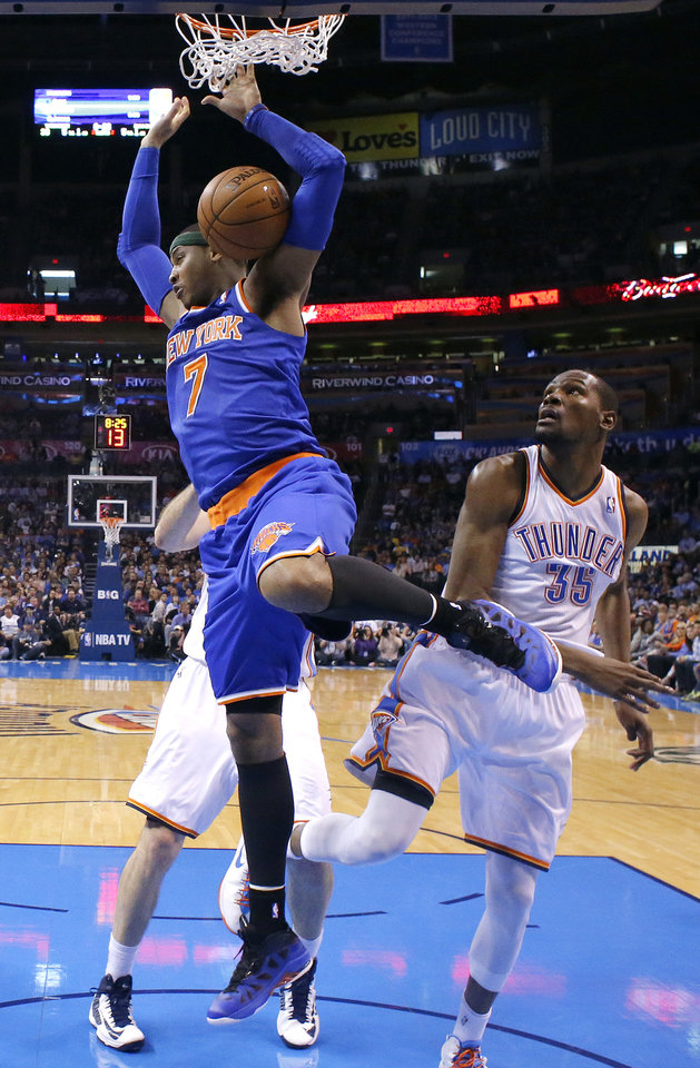 New YorK\'s Carmelo Anthony (7) dunks in front of Oklahoma City\'s Perry Jones (3) during NBA basketball game between the Oklahoma City Thunder and the New York Knicks at the Chesapeake Energy Arena, Sunday, April 7, 2010, in Oklahoma City. Photo by Sarah Phipps, The Oklahoman