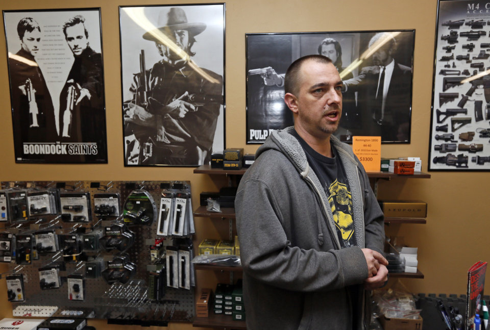 WEAPONS STORE: Darren Burger, co-owner of Locked and Loaded, talks about firearms at his store, 14451 NE 23rd Street, in Choctaw, Okla., Wednesday, Jan. 16, 2013. Photo by Nate Billings, The Oklahoman