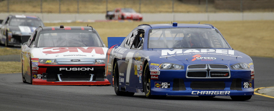 Photo -   Driver Robby Gordon (7) leads Greg Biffle during practice for Sunday's NASCAR Sprint Cup Series auto race Friday, June 22, 2012, in Sonoma, Calif. (AP Photo/Ben Margot)