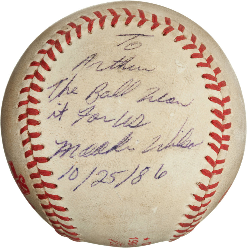 "Photo -   This undated image, provided by Heritage Auctions, shows the ""Buckner Ball,"" the baseball that dribbled between the legs of Boston Red Sox first baseman Bill Buckner during the 10th inning of Game Six of the 1986 World Series. The error gave the New York Mets the win and the team went on to beat the Red Sox the next night to win the World Series. The writing, by Mookie Wilson addressed to Mets traveling secretary Arthur Richman says: To Arthur, the ball won it for us, Mookie Wilson, 10/25/86. Heritage Auctions says the ball is expected to bring in more than $100,000 on Friday, May 4, 2012, in Dallas. (AP Photos/Heritage Auctions)"