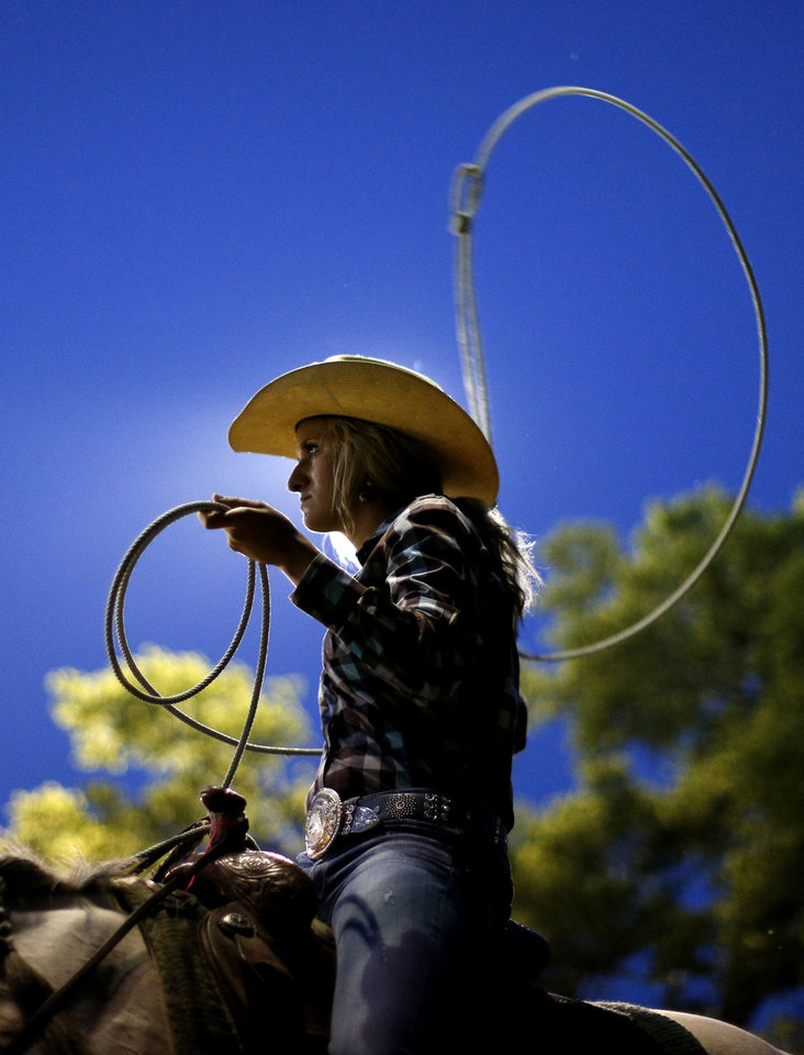 Karly Benzie, of Alva, warms up before competing in breakaway roping in the annual LibertyFest Rodeo in Edmond. PHOTO BY BRYAN TERRY, THE OKLAHOMAN. <strong>Bryan Terry - THE OKLAHOMAN</strong>