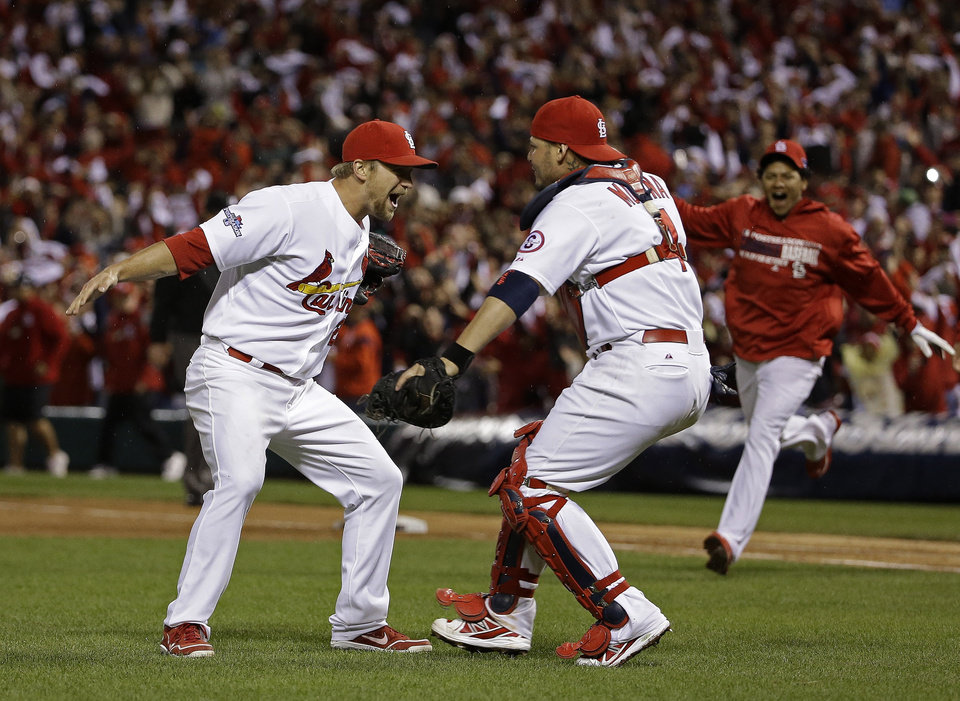 Photo - St. Louis Cardinals catcher Yadier Molina and Trevor Rosenthal celebrate after Game 6 of the National League baseball championship series against the Los Angeles Dodgers Friday, Oct. 18, 2013, in St. Louis. The Cardinals won 9-0 to win the series. (AP Photo/David J. Phillip)