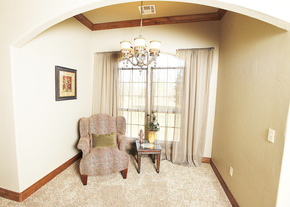 Photo - A ceiling arch defines the sitting area in the master bedroom at 12005 Tuscany Ridge.  PAUL B. SOUTHERLAND - The Oklahoman