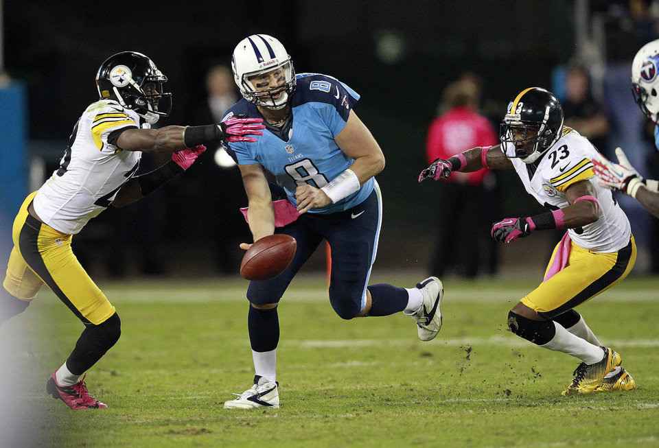 Tennessee Titans quarterback Matt Hasselbeck (8) flips the ball to a receiver while under pressure from Pittsburgh Steelers\' Cortez Allen, left, and Keenan Lewis (23) during the first half of an NFL football game Thursday, Oct. 11, 2012, in Nashville, Tenn. (AP Photo/Wade Payne)