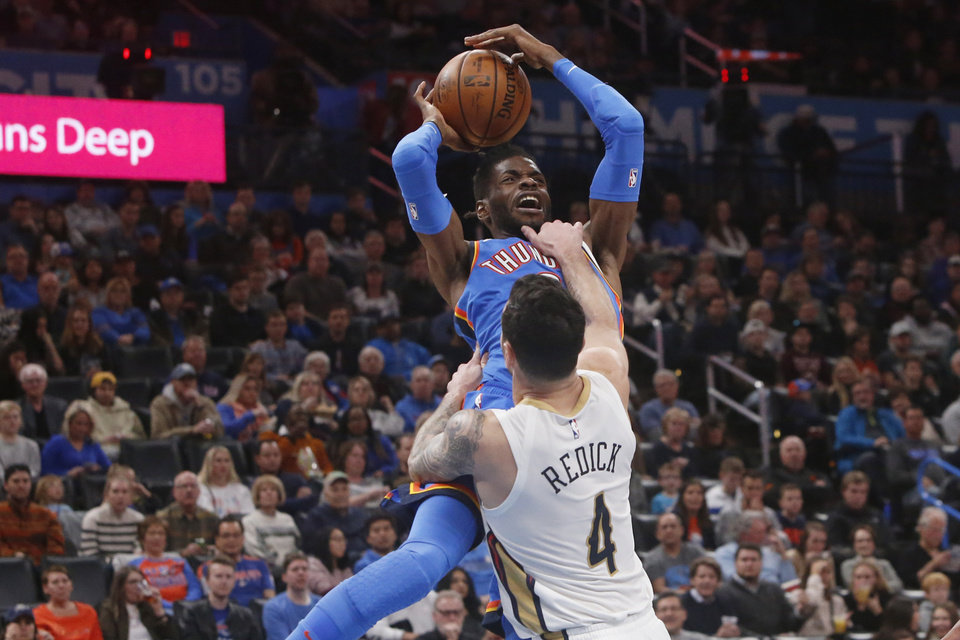 Photo - Oklahoma City Thunder center Nerlens Noel, rear, is fouled by New Orleans Pelicans guard J.J. Redick (4) as Noel shoots during the first half of an NBA basketball game Friday, Nov. 29, 2019, in Oklahoma City. [AP Photo/Sue Ogrocki]