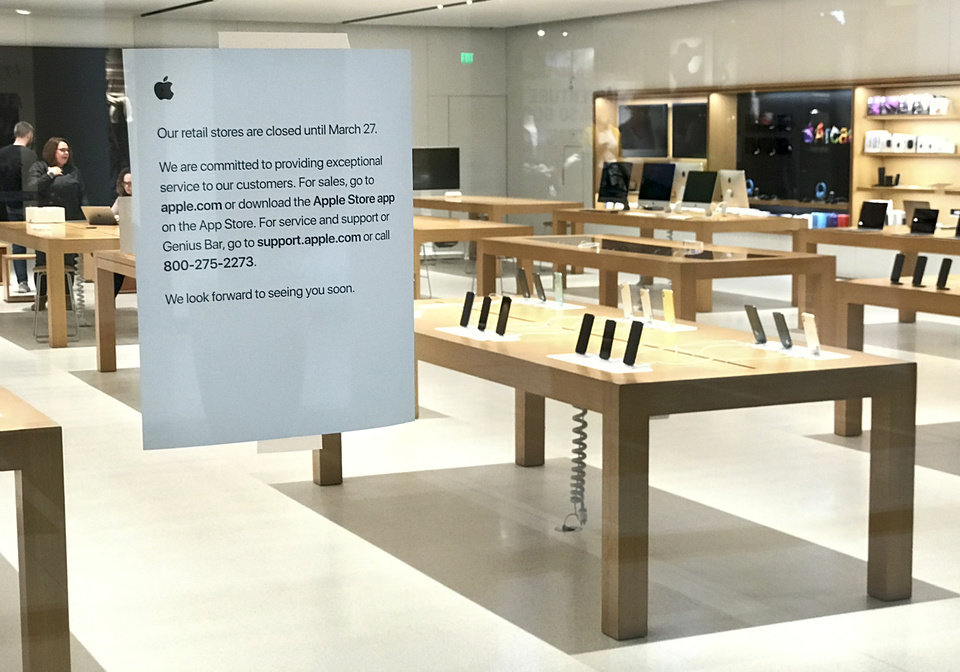 Photo - A sign on the exterior of the Apple Store in Penn Square Mall gives information about its temporary closure, in Oklahoma City, Monday, March 16, 2020. Apple has closed its retail stores until March 27 because of the coronavirus pandemic. [Nate Billings/The Oklahoman]