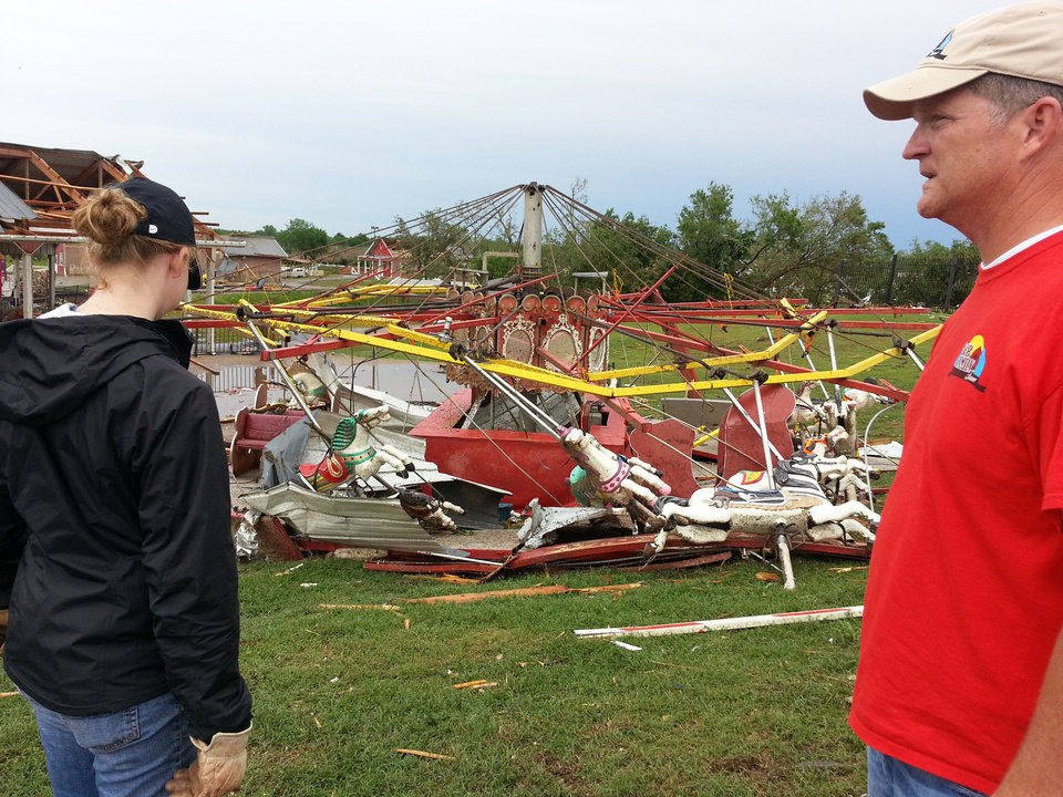 Photo - Tom Orr and his daughter, Shelby, view the destroyed carousel at the Orr Family Farm in Moore. Photo by Ed Godfrey, The Oklahoman